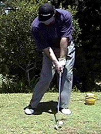 nick faldo hitting golf shot iron