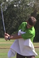 towel under arm golf swing drill