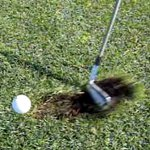 Divot in front of the ball